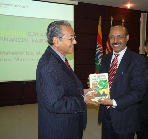 "Dr Shahid Qureshi presented his Book ""War on terror and Siege of Pakistan"" to HE Mahatir Mohammad Prime Minister of Malaysia"
